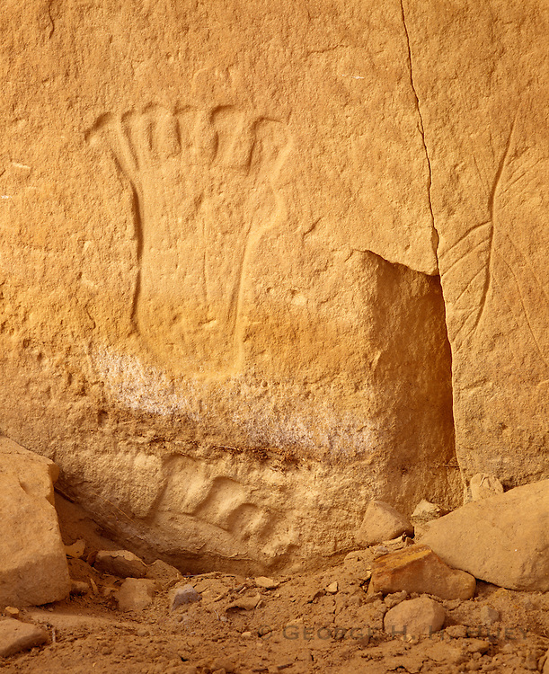 0204-1022C ~ Copyright: George H. H. Huey ~ Anasazi culture petroglyph of two, six-toed feet, on sandstone rock face. Chaco Culture National Historical Park, New Mexico.