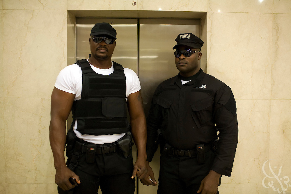 Nigerian security guards working for the ThisDay Festival block the entrance of an elevator in the lobby of the Abuja Hilton July 11, 2008 in Abuja, Nigeria. Pop stars Jay-Z, Rihanna and Usher joined local musicians and super models Naomi Campbell and Tyson Beckford at the Abuja leg of the festival, which is an annual event designed to raise awareness of African issues while promoting positive images of Africa using music, fashion and culture..