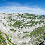 180 degree panorama looking from west to north to east from Rotsteinpass, in the Alpstein limestone mountain range, Appenzell Alps, Switzerland, Europe. Appenzell Innerrhoden is Switzerland's most traditional and smallest-population canton (second smallest by area). This image was stitched from multiple overlapping photos.