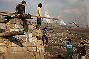 Children play on an abandoned home in the Velka Ida Roma settlement near the US Steel plant.