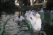 Israel, Yardenit Baptismal Site In the Jordan River Near the Sea of Galilee, A group of Russian Orthodox pilgrims being Baptized