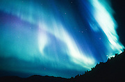 Alaska. Bright mystery of the northern night, Aurora Borealis send sheets of color shimmering through the sky.