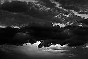 A black and white fine art, decorative, digital photographic image of clouds at dusk in North Las Vegas by Chicago based photographer Javet M. Kimble made in July of 2012.