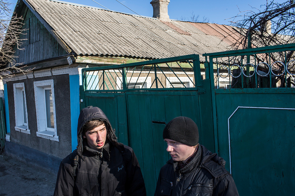 LUHANSK, UKRAINE - MARCH 16, 2015: Pavel Pavlov, left, and Aleksandr Kryukov outside the house where Kryukov lives with his grandmother in Luhansk, Ukraine. The two have created a series of popular YouTube videos involving scientific experiements. CREDIT: Brendan Hoffman for The New York Times