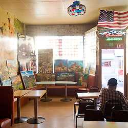 061112       Brian Leddy.Joe Zecca, owner of the American Bar, watches from inside the establishment during ArtsCrawl on Saturday evening. The monthly event was the largest to date, with hundreds of people filling the streets and shops of downtown Gallup.