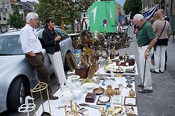 Sunday antiques market on street in Tongeren in Belgium