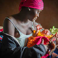 Nurse Kaarta Banya cares for a baby at the The Bayamah Health Outpost in Sierra Leone.