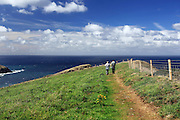 A couple walks along the South West Coast Path near Crackington Haven in northern Cornwall
