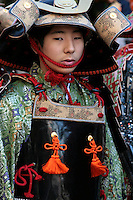 Young Japanese boy kitted out in samurai gear. Samurai is the term for the military nobility of pre-industrial Japan. The samurai followed a set of written rules called the Bushido. Samurai teachings can still be found today in modern day society especially in the world of Japanese martial arts.  Various samurai re-enactments are held throughout Japan, with lots of attention to detail in  costumes and demeanor - not all that much changed since the 12th century.