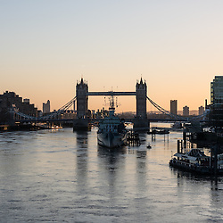 London, UK - 25 December 2014: sunrise behind Tower Bridge in London on early Christmas morning.