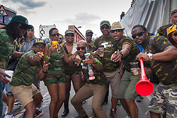 London, August 24th 2014. Revellers pose for the camera as 2014's Notting Hill Carnival in London, celebrating West Indian and other cultures attracts hundreds of thousands to Europe's biggest street party.