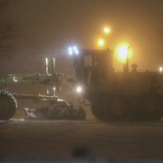 A Cat 140M Motor Grader removing snow near Chapman Rd as snow falls Friday, Jan, 22, 2016 in Newark.<br /> <br /> A massive blizzard dumps snow in Newark, and eastern United States on Friday, with mass flight cancellations, five states declaring states of emergency.