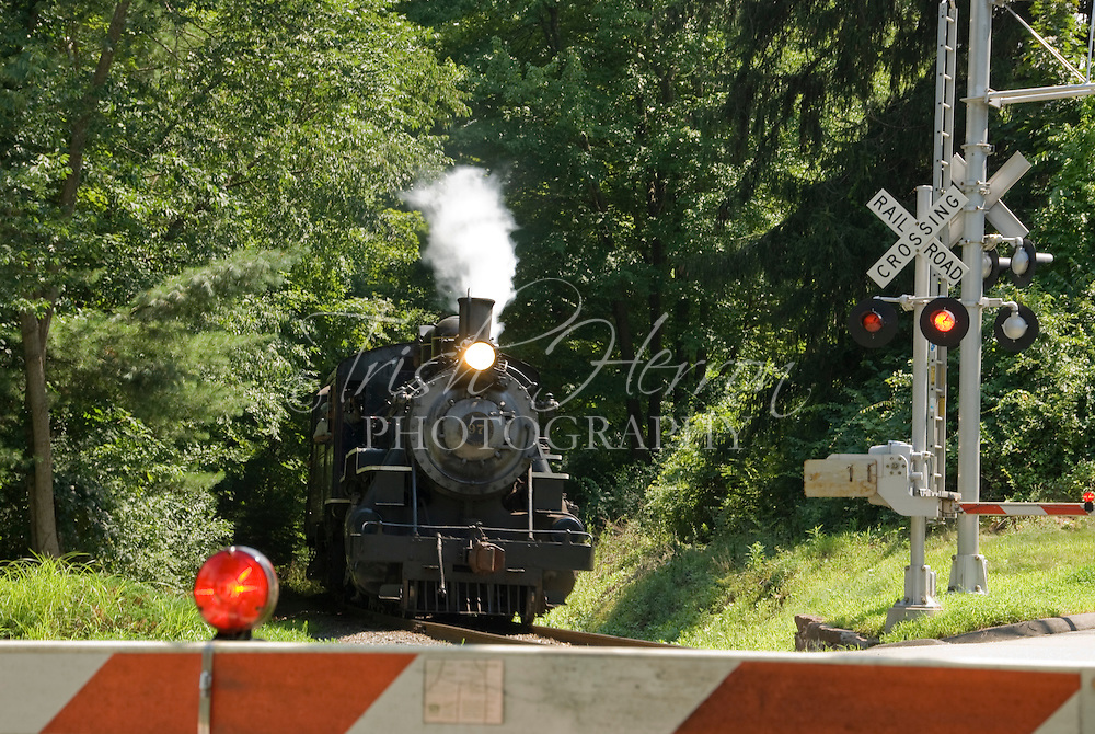 The Essex Steam Train approaches a road crossing in Hamden, Connecticut.