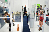 UK. London. The Frieze Art Fair in Reagent's Park..Photo shows people smoking in special smoking booths, a Frieze Project called 'Norma Jeane, The Straight Story'..Photo by Steve Forrest
