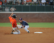 Mississippi's Kevin Mort (6) tags out Virginia's Keith Werman (2) on a steal attempt during an NCAA Regional game at Davenport Field in Charlottesville, Va. on Saturday, June 5, 2010.