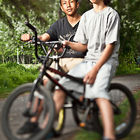 East High School 9th graders, Dahrnelle Keller and Evan Kosbruk, on the bike trail near Valley of the Moon Park, Anchorage