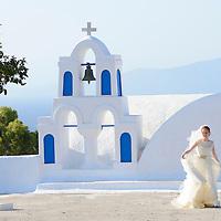 Bride walking past church,Santorini, Kyclades,South Aegean, Greece,Europe