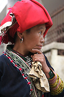 The red dzao or dao people are a branch of the hilltribe of the Yao people, descending from China.  The red dzao or dao are characterized by their red scarfs, hats or headgear and are frequently seen on market days in the Sapa area and small villages in the northern montagnard areas of Vietnam.