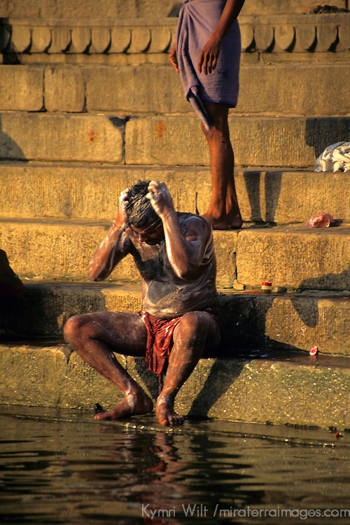Asia, India, Uttar Pradesh, Varanasi. Indian man bathing in the ghats on the Ganges River.