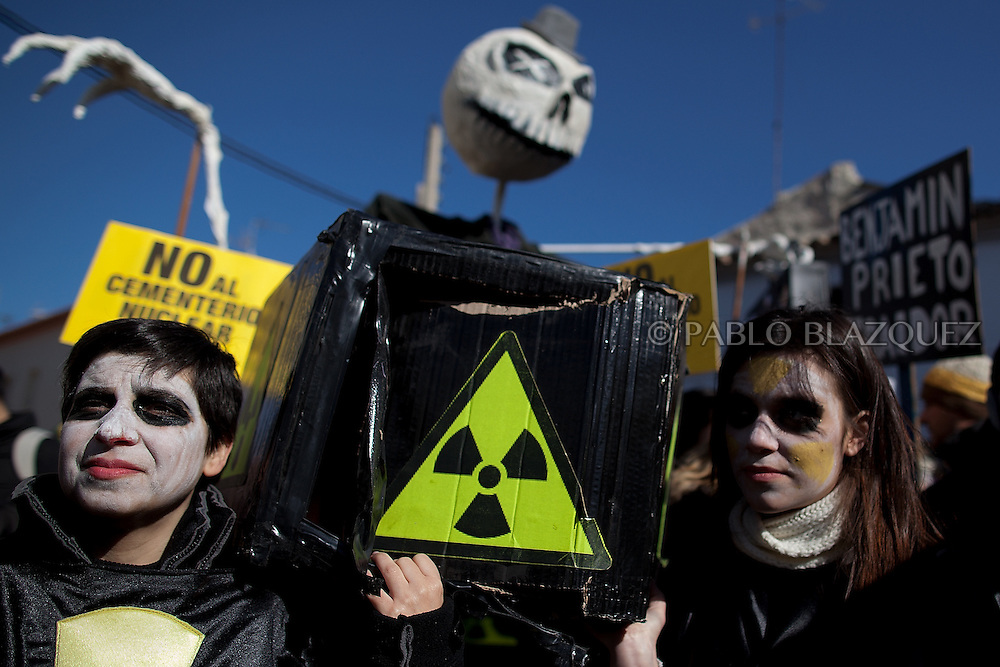 People attend a demonstration organized by environmentalists against the possible construction of a nuclear waste storage in Villar de Cañas, near Cuenca , on February 12, 2012. Placards read 'Agains the nuclear cemetery.