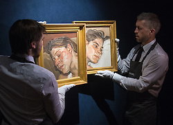 Christies, St James, London, February 5th 2016. Gallery workers hang Lucian Freud's Head of Ib (left), next to Head of Esther, a pair of Freud's portraits of his daughters, with each piece expected to fetch up to £3.5 million at auction, in preparation for the 20th Century Art Sale Preview. ///FOR LICENCING CONTACT: paul@pauldaveycreative.co.uk TEL:+44 (0) 7966 016 296 or +44 (0) 20 8969 6875. ©2015 Paul R Davey. All rights reserved.