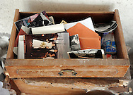 An abandoned drawer full of family pictures