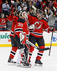 February 13, 2008; Newark, NJ, USA;  New Jersey Devils defenseman Colin White (5) congratulates New Jersey Devils goalie Martin Brodeur (30) on his 30th win of the season at the Prudential Center in Newark, NJ. Brodeur has reached the 30-win mark an NHL Record 12 straight seasons.
