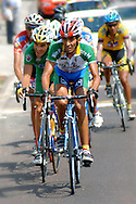 Athletes compete in stage eight of the annual Vuelta al Tachira cycling race in San Cristobal, Venezuela on Saturday, Jan. 12, 2008. Local and international teams will ride over 1580 kilometers and climb a 1500 meter altitude differential throughout the competition. The grueling, 13-stage race through the Andes mountains is hailed as the premier cycling event in South America.
