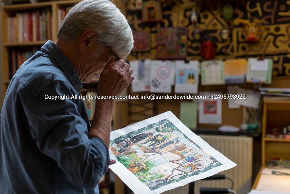Brussels, Belgium 29 August 2014. Johan De Moor, famous Belgian cartoonist and son of Bob De Moor, right hand of Tintin's Hergé, inspects his own work  in his studio. © Sander de Wilde pour M le magazine du Monde