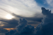 Towering storm clouds build over the Pacific Ocean west of the Hawaiian island of Maui. This scene was captured from the summit of Mount Haleakala.