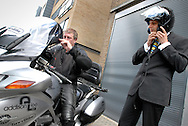 UK. London. Alan Vann, a Driver for Addison Lee which offers a limousine service for businessmen in London..Photograph shows Alan with his bike and a customer..Photo©Steve Forrest/Insight-Visual for The New York Times .Tel: +44 (07977 470 974.steve@insight-visual.com