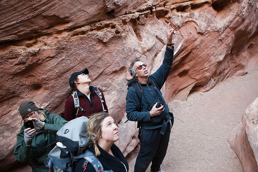 Geomorphology professor Robert Anderson points out features on the canyon walls to his students from the University of Colorado in Little Wild Horse Canyon, San Rafael Swell, Utah.