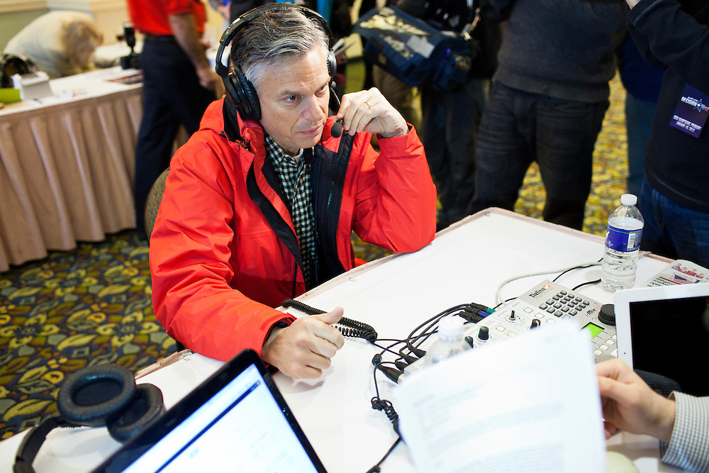 Republican presidential candidate Jon Huntsman does a radio interview at the New England College Convention on Friday, January 6, 2012 in Concord, NH.