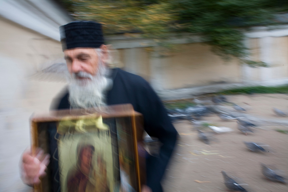 An orthodox priest carries an icon near the Alexander Nevsky Monastery in St. Petersburg, Russia, on Thursday, September 13, 2007.
