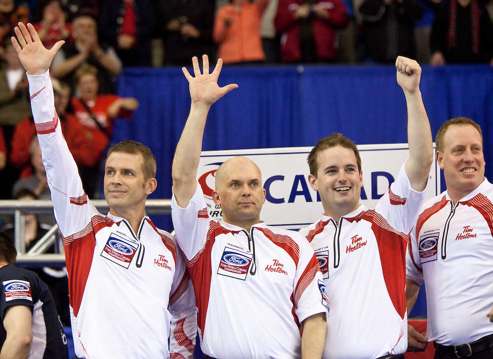 Canadian skip Jeff Stoughton, left, third Jon Mead, second Reid Carruthers and lead Steve Gould celebrate their victory over Scotland in the gold medal game at the Ford World Men's Curling Championships in Regina, Saskatchewan, April 10, 2011.<br /> AFP PHOTO/Geoff Robins