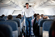GOP presidential candidate Mitt Romney speaks to staff members while flying from Sparks to Elko, Nevada, February 3, 2012.
