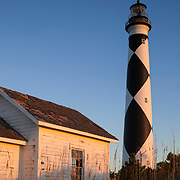 NC00880-00....NORTH CAROLINA - Sunset on  Cape Lookout Lighthouse on the South Core Banks in Cape Lookout National Seashore.