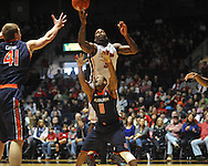 "Ole Miss' Murphy Holloway (31) grabs a rebound over Auburn guard Josh Wallace (11) and scores at the C.M. ""Tad"" Smith Coliseum on Saturday, February 23, 2013.  (AP Photo/Oxford Eagle, Bruce Newman)"