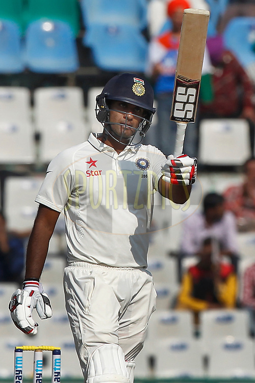 Jayant Yadav of India raises his bat after scoring 50 runs during day 3 of the third test match between India and England held at the Punjab Cricket Association IS Bindra Stadium, Mohali on the 28th November 2016.<br /> <br /> Photo by: Deepak Malik/ BCCI/ SPORTZPICS
