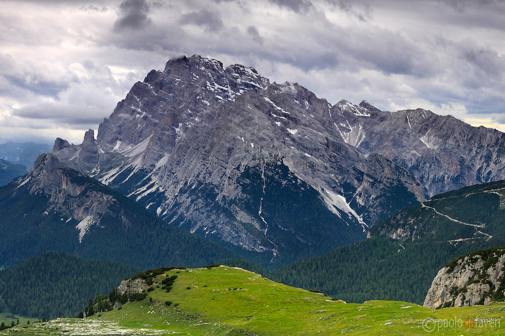 A view of Monte Cristallo, one of the many massifs in the dolomiti Bellunesi, under some ominous clouds. Taken about 1 hour before sunset on an evening of mid June, from the plains surrounding the Tre Cime di Lavaredo/Drei Zinnen.