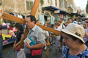 Israel, Jerusalem, Pilgrims bearing a Cross at a Via Dolorosa Procession,
