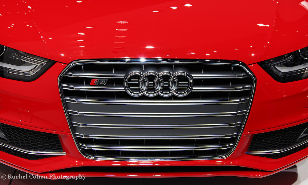 &quot;2013 Audi S4 Front Grille&quot;<br /> <br /> A beautiful image of the front grille, logo, bumper and part of the hood of the awesome Audi S4 in bright red!!<br /> <br /> Cars and their Details by Rachel Cohen