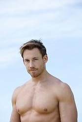 shirtless rugged man outdoors