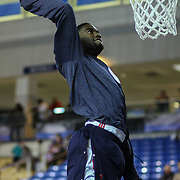Delaware 87ers Forward Norvel Pelle (15) dunks during warm ups prior to a NBA D-league regular season basketball game between Delaware 87ers and Idaho Stampede Thursday, Dec. 12, 2013 at The Bob Carpenter Sports Convocation Center, Newark, DE