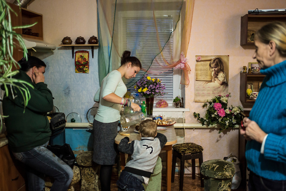 DNIPROPETROVSK, UKRAINE - OCTOBER 12: Svitlana Kostromina (R) in the kitchen at the home of Vira Luchnikova (L), part of her church's congregation, where she, her daughter, and her granddaughter are living after fleeing fighting in Luhansk in Ukraine's East on October 12, 2014 in Dnipropetrovsk, Ukraine. The United Nations has registered more than 360,000 people who have been forced to leave their homes due to fighting in the East, though the true number is believed to be much higher. (Photo by Brendan Hoffman/Getty Images) *** Local Caption *** Svitlana Kostromina;Vira Luchnikova