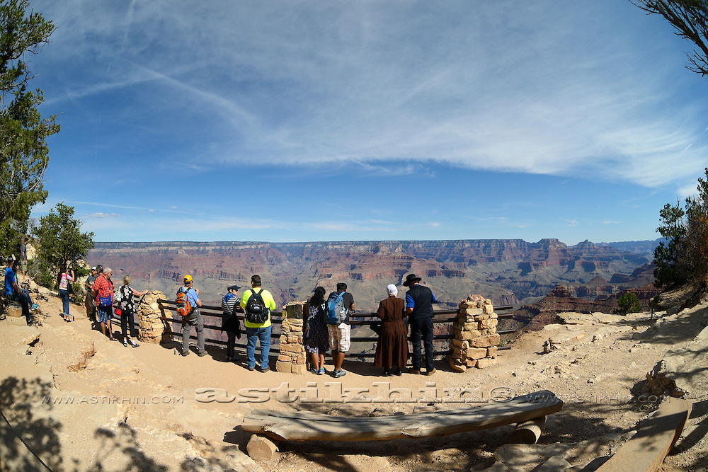 People Looking Out Over The Grand Canyon, Arizona.