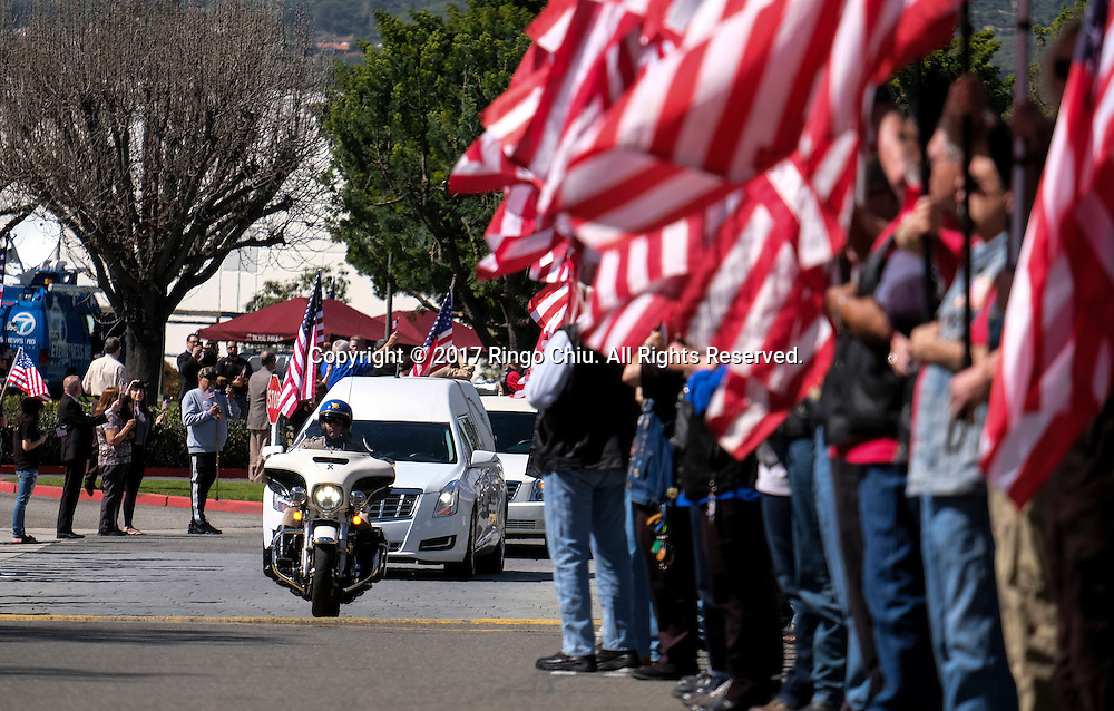 A police motorcycle leads the hearse carrying the body of Whittier Police Officer Keith Boyer arrives at Rose Hills Memorial Park in Whittier, Calif., Friday March 3, 2017. Boyer, who was fatally shot after responding to a traffic crash, was remembered today by thousands of law enforcement officers, friends and family as a dedicated public servant, talented drummer, loving friend and even a ``goofy'' dad.(Photo by Ringo Chiu/PHOTOFORMULA.com)<br /> <br /> Usage Notes: This content is intended for editorial use only. For other uses, additional clearances may be required.