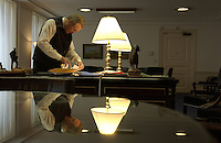 Secretary of Defense Donald H. Rumsfeld works in his office at the Pentagon on Dec. 16, 2003. Secretary of Defense Donald H. Rumsfeld and Gen. Pace will give reporters an operational update on Operation Iraqi Freedom..