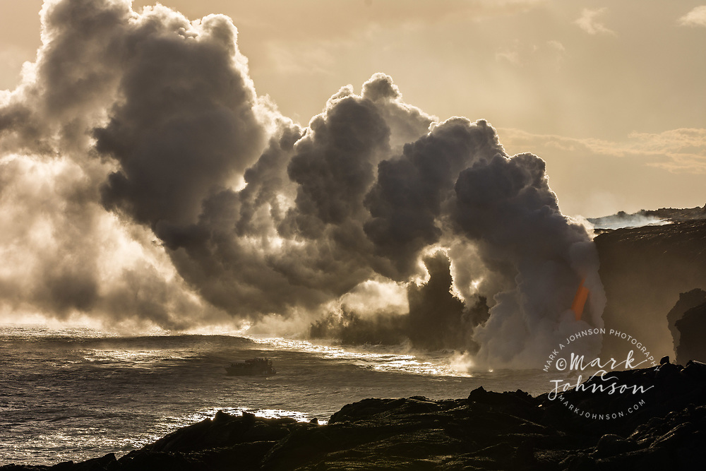 Tour boat viewing the lava flow into the ocean at Kamokuna, Big Island, Hawaii