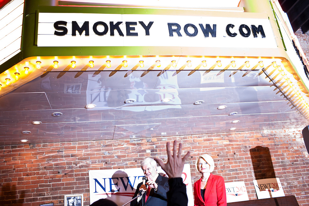 Republican presidential candidate Newt Gingrich, joined by his wife Callista Gingrich, speaks to supporters at Smokey Row Coffee House on Tuesday, December 20, 2011 in Oskaloosa, IA.